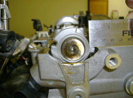 With the 2.4L intake cam positioned with #1 cylinder vales are fully open at max lift, or if the exhaust cam is positioned with #4 cylinder valves fully open, the cam reluctor should be flush with and parallel to the rocker cover gasket surface. If not, the reluctor has moved and the cam must be replaced.