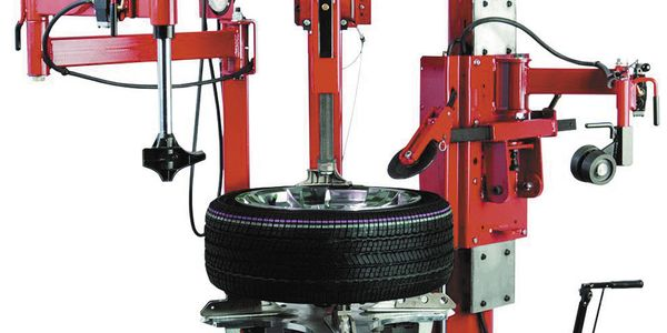 The Coats GTS-90 tiltback tire changer's powered roller disk helps with bead loosening, bottom...
