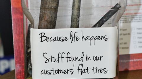 A jar full of items actually found inside customers' tires. Notice the wood stick? Looks like a...