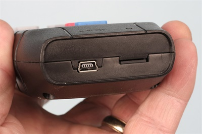 Updates are easily performed via a mini-USB port and an SD card located in the base of the handset. To remove the SD card (seen at right), push the card in with your fingernail, and the card releases for extraction.