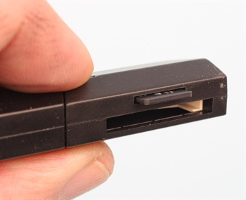 Insert the SD card into the USB adapter. Stick the USB adapter into your PC for update download.