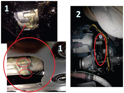 Viewing the EPAS steering rack from underneath the sub-frame assembly, it shows the condition of the wax, with globules highlighted by red circles.
