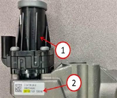 EGR valve bottom view. 1) EGR valve; 2) EGR valve information tag.