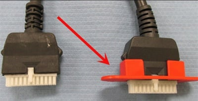 The adapter/guard is installed in this example on the end of the SIDI cable.