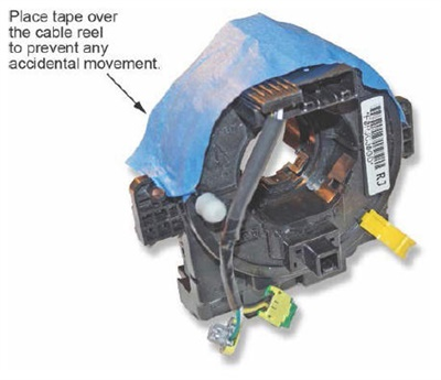 Place tape over the cable reel to prevent accidental movement of the steering angle sensor.