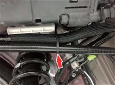 Install the new clamp (P/N 90463-13003) or equivalent 7.5-inch nylon cable tie in the location shown.