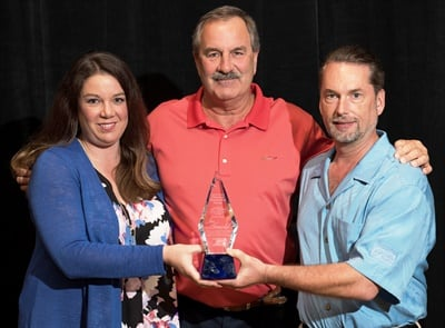 Ashlee Arnold presented her father, Jim Arnold, with the Art Fisher Memorial Award award along with Bo Fisher, chairman of Federated Auto Parts.
