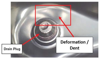 An example of pan deformation at the drain plug area.