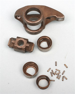 The un-caged needle bearings used in OE rocker arms can dislodge and scatter.