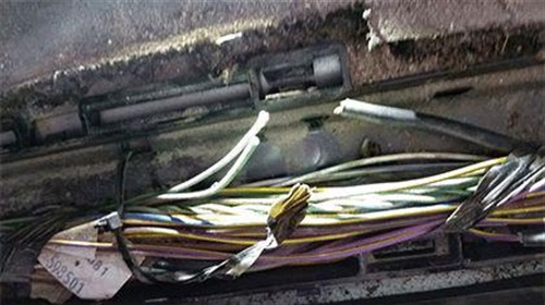 As an example, circuit 5199 wiring should be checked under the driver's sill plate.