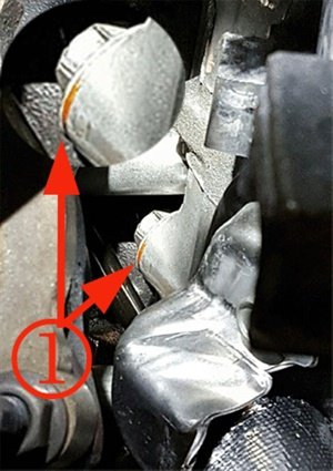 Inspect the outer cylinder head bolt locations for signs of coolant leaks.
