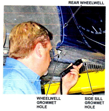 With grommets removed, shine a light into the side sill hole to see the wheelwell hole.