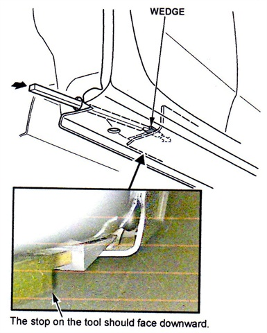 Insert the wedge by hand into the insertion point, placing the wedge as far outboard as possible.
