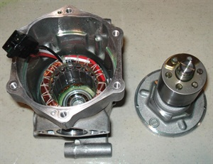 Prius Gen II (2004-2009) compressor with rotor removed and stator still in case.