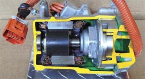 Prius Gen II compressor with internal permanent magnet three-phase motor.