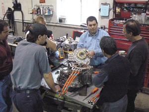 An ACDC trainer explains how a CVT, equipped with electric motors inside, powers a Prius hybrid.