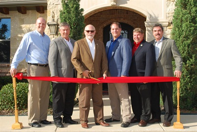 A ribbon-cutting ceremony during ASA's open house included (from left to right): Dan Stander, Collision Division director; Roy Schnepper, secretary/treasurer; Darrell Amberson, chairman; Donny Seyfer, chairman-elect; Bob Wills, Mechanical Division director; and Gary Keyes, general director. Not pictured: Bill Moss, general director.