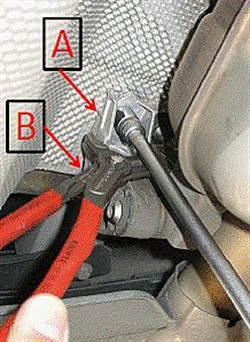 Loosen the rear exhaust mount to relieve tension, then re-tighten, while holding the mount with pliers.
