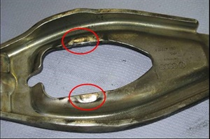 In this example, the release bearing has pressed against the release lever. Note the wear marks.