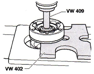 Using specialty tools VW 402 and VW 409, press the inner CV joint from the drive shaft.
