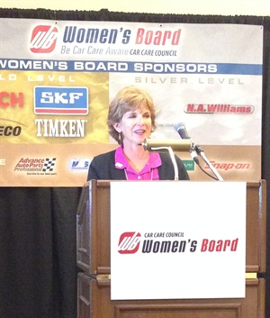 AutoTex Windshield Wipers' Paula Lombard accepts the Woman of the Year award.