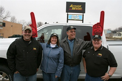 Left to right: Jason Madison, Arnold Motor Supply salesperson; Joni and Greg Meckley, pickup truck winners; and Jerry Bachman, Arnold Motor Supply store manager.