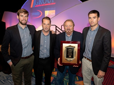 Art Fisher's grandsons, Riley Fisher (far left) and Evan Fisher (far right), join father Bo Fisher (second from left) to present longtime Federated CEO Rusty Bishop with the prestigious Art Fisher Memorial Award.