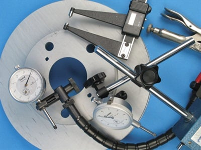 A proper brake service simply cannot be achieved without inspecting for rotor thickness and lateral runout. Precision measuring tools are a must.