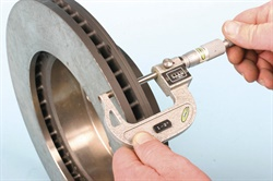 Brake rotor thickness should always be checked at multiple clock positions on the disc surface with a calibrated micrometer.