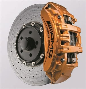 High-dollar luxury performance cars often feature premium-performance brake components such as multiple-piston calipers and large diameter rotors. This example is featured in 2009-2012 Mercedes-Benz AMG vehicles, featuring 6-piston calipers and ceramic-compound discs. You're not going to find these at your local parts store.