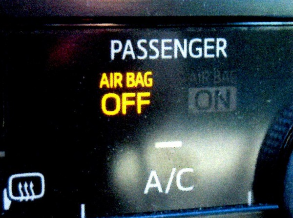 "After the bulb check, the passenger seat airbag light will display ""AIR BAG OFF"" if the passenger seat is unoccupied (or if the OCS ECU determines that the occupant does not meet the adult criteria)."