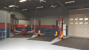 The shop's latest addition features a taller ceiling, color-coded walls, painted floor and three additional lifts.