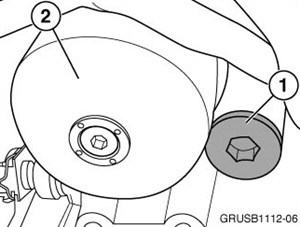 The oil pump volume control valve (1) is located next to the engine oil filter (2).