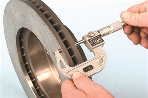 Check rotor disc thickness with a micrometer. This allows you to determine of the rotor has worn beyond the recommended minimum thickness limit. If brake vibration (pedal pulsation) is a concern, in addition to checking rotor lateral runout, a check of rotor thickness for variations can help to determine rotor condition. Measure for thickness at a minimum of four evenly spaced clock locations.