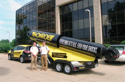 Brand ambassadors Michael MacDonald, social media specialist (left); and Kyle Keech, media relations specialist; are traveling to more than 50 U.S. cities in this Monroe mobile marketing vehicle to promote the importance of having shocks inspected at 50,000 miles.