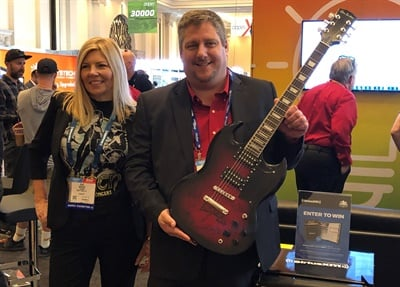 Bolt On Technology gave AAPEX attendees who are shop owners a chance to win an autographed guitar, vacation package and other prizes. The contest helped launch Bolt On Technology's new collaboration with SiriusXM. Pictured are Gail Berger, vice president and general manager for automotive remarketing at SiriusXM, and Mike Risich, Bolt On Technology founder and CEO.