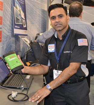 Bosch's Ravi Subramanyan demonstrates the Mastertech VCI (M-VCI) scan tool at AAPEX 2012.