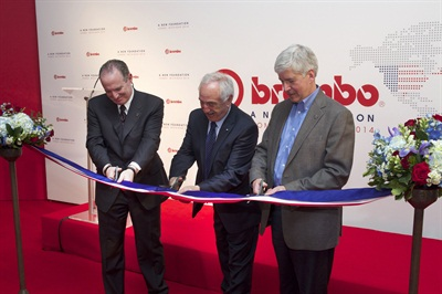 Alberto Bombassei, chairman of Brembo S.p.A.; Daniel Sandberg, president and CEO of Brembo North America; and Michigan Governor Rick Snyder cut the ceremonial ribbon to mark the grand opening of Brembo's expanded manufacturing operations in Homer, Mich.
