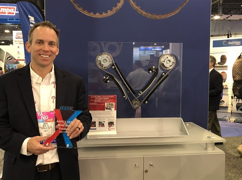 Brian Wheeler, vice president of business development and marketing for Cloyes, holds the AAPEX best new product award the company won for its VVT Chain Kits.