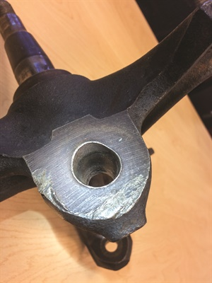 Note the elongated hole in this steering knuckle's ball joint hole. Improper torqueing of the joint stud may have allowed the stud to wobble inside the bore.