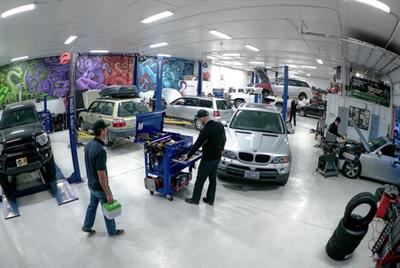 The service area is extremely clean and well-lit. The wall murals provide an eclectic and visually stimulating work environment for the technicians.