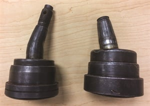 Here's a great example of OE ball joints that failed due to lack of lubricity. The stud ball at the left was so dry that it galled and became stuck in its socket, while suspension movement overcame the strength of the stud, bending it. The joint at the right moved within its ball socket to the point there the tensile strength of the stud threads failed and snapped.