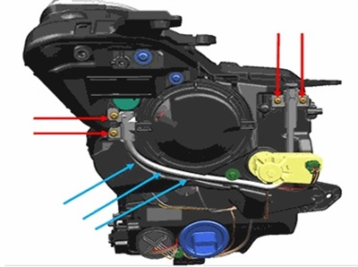 For base headlamps, remove the four screws (red arrows), remove and replace the aim adjuster cable.