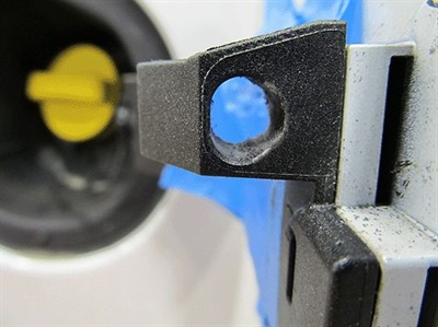 Carefully remove 2 mm of material using a small fine round file.