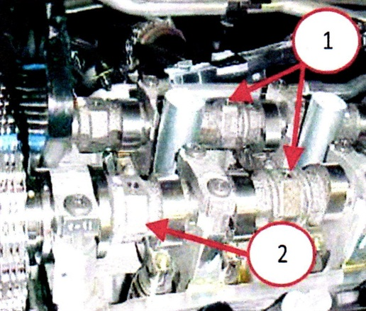 The two camshaft datum holes should point upwards (Figure 1). The right side camshaft phaser arrows should point away from each other and scribe lines should be parallel to the valve cover sealing surface (Figure 2).