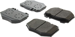 Examples of PosiQuiet pads. Pad-to-backing-plate retention is critical to establish a permanent bond between the two materials. A positive-molding approach is used that features a series of holes in the backing plate. During the pad molding process, pressurization forms pad material into these holes, essentially making the pad material an integral part of the backing plate. (Courtesy of Centric)
