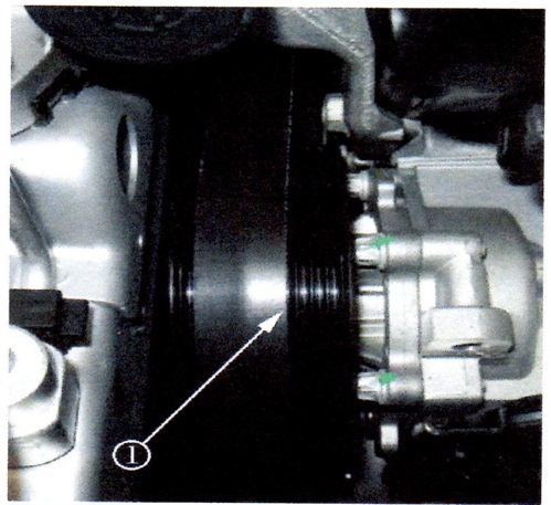 The above photo illustrates the incorrectlocation of the accessory drive belt. Belt misalignment with grooves exposed can cause the belt to wear quickly.