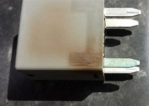 Inspect relays for discoloration and/or distortion.