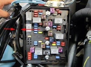 Check the cooling fan motor amp draw at the wiring block. Note the location marked by arrows.
