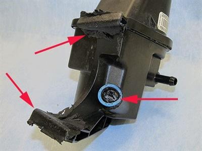 Evidence of super-heated power steering fluid damage.